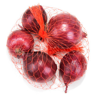 Red onion in packing from red net on white background