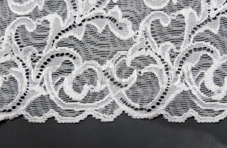 White lace with pattern in the manner of flower on black background