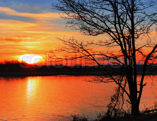 Sunset over the lake in early spring