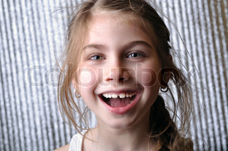 portrait of a little happy 6 year old girl