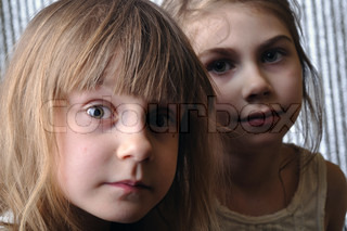 close-up portrait of two serious girls