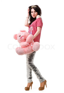 Young sexy girl with a teddy bear isolated on white background.