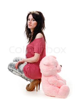 Young sexy girl sits with a teddy bear isolated on white background.