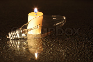 Candle And Electric Bulb