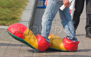 pedestrian on the street in clown shoes