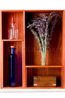 Alternative medicine equipment and lavender in a brown shelf.