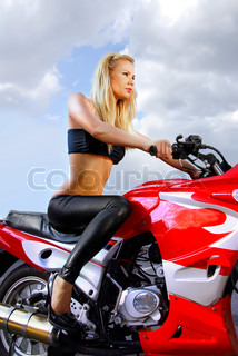 pretty blonde woman on a big red motorcycle