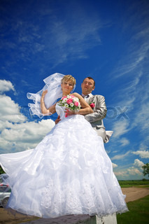 bride and groom on the sky