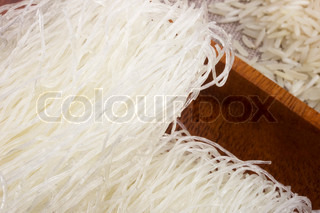 Close-up photograph of raw white rice noodles.