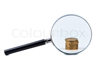 Magnifier and stack of coins isolated on a white background.