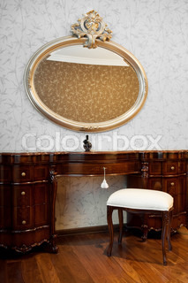 Night table and mirror in a modern bedroom