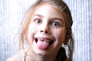 close-up portrait of a cheerful girl with her tongue out