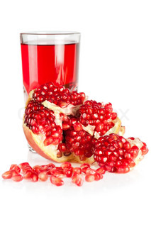 Fresh ripe pomegranate and glass of juice on white background. SDOF