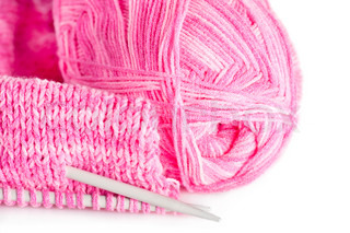 Handmade needle knitted pink canvas and yarn ball