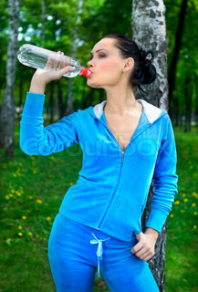 woman with bottle on nature