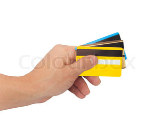three credit cards in hand