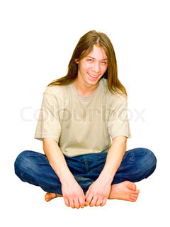 portrait of a young gay guy sitting in the lotus position