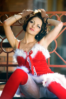 beautiful happy sexy girl wearing santa claus clothes on city background