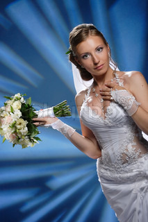 A beautiful woman at wedding with bridal bouquet