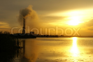 Chimneys of  thermal power plant in time of sunset