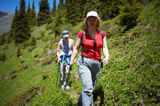 Two woman tourist walking in the mountain forest