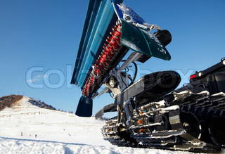 Machines ready for work on skiing slopes of the swiss alps ...