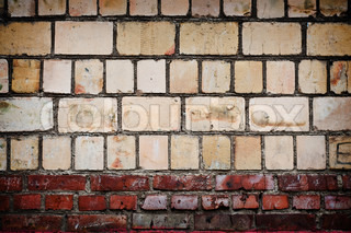 vintage cracked concrete brick wall with artistick shadows added