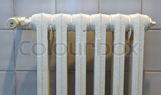 An old radiator to heat a home. Save energy