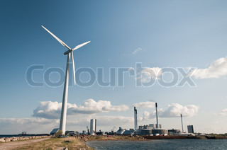 Wind turbine with power plant behind