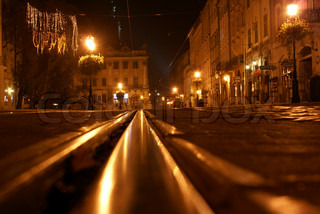 Rails in old city at night
