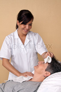A nurse washes the patient. Care in a hospital