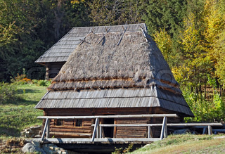Ancient traditional hut with watermill, Pirogovo, Kiev
