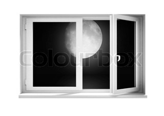The full moon at night behind a window