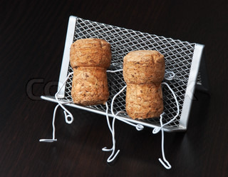 two wine corks are sitting on a bench