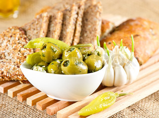 olives and garlic with tasty Italian and grain bread