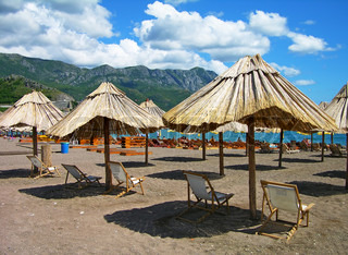 Beautiful beach with chairs and umbrellas