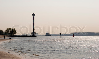 Blankenese lighthouse, beach and river Elbe, Hamburg, Germany.