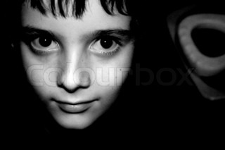 black and white head shot of boy