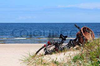 bicycle on the beach in front of the baltic sea