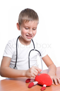 cute young boy playing doctor with syringe