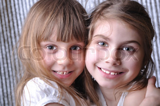 close-up portrait of two 6-7 year old girls