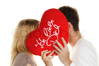 Loving couple kissing behind a heart. Love is beautiful. Secret love