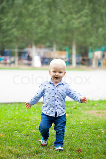 9c5c10dc3 Happy little boy running on the ...