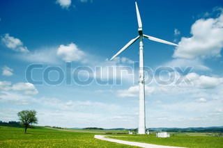 Wind Turbine in a summer landscape with some clouds