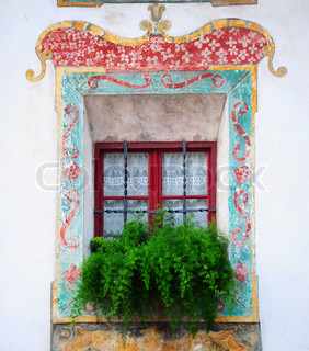 Typical Italian Window  Decorated With Fresh Flowers And Fresco