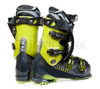Pair green-dark ski shoe insulated on white background