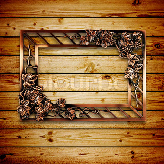 bronze frame of wooden background