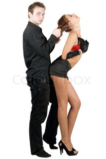 Sexy playful young couple. Isolated on white background