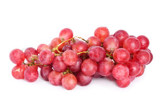 Fresh red grapes branch with water drops. Isolated on white background