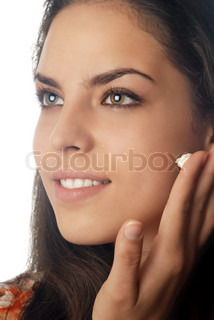 Photo of smiling model with beauty cream